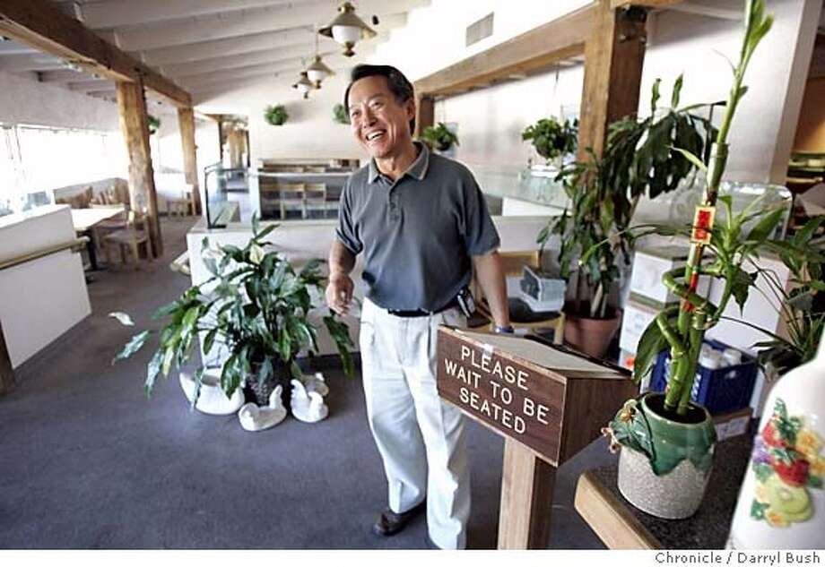 cookbook_161_db.jpg  Owner James Kim smiles as he tells former customers goodbye inside the now closed, Cook Book restaurant, which was evicted from the Town & Country Village Shopping Center.  Event on 8/4/05 in Palo Alto.  Darryl Bush / The Chronicle MANDATORY CREDIT FOR PHOTOG AND SF CHRONICLE/ -MAGS OUT Photo: Darryl Bush