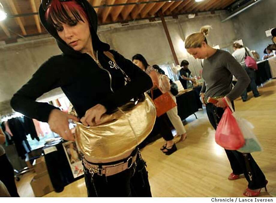 BABES07_0189.jpg_  Ali Barone (cq) from LA and Emily Feinstein from SF are both trying on Hand bags and belts from designer Allison Burns. Seems, everyone wants to be a VIP. The best way to start looking like one is to shop like one. Celebrities and other well-heeled people in London, New York, Los Angeles and Chicago know about �Billion Dollar Babes,�� now San Franciscans are becoming familiar with it, too. Top designer clothing to the masses for two days, once or twice a year. The first day is invitation only; the second day is open to the public, but only if you register online first. So there�s still an air of exclusivity, which is what being � or looking � like a VIP is all about. By Lance Iversen/San Francisco Chronicle MANDATORY CREDIT PHOTOG AND SAN FRANCISCO CHRONICLE. Photo: Lance Iversen
