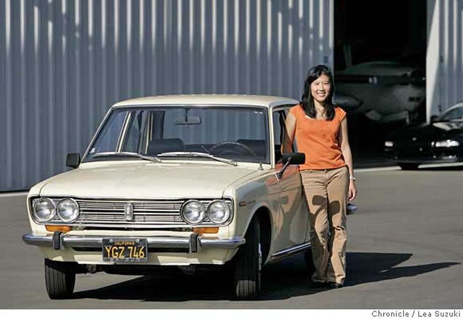 "motorXXmyrideCHANG_013_ls.JPG  Deborah Chang with the Datsun 510, nicknamed ""Miss Dottie 2"" (for CARS section My Ride series) on Monday, October 23, 2006. Photo by Lea Suzuki/The San Francisco Chronicle  Photo taken on 10/23/06, in Hayward, CA. **(themselves) cq. MANDATORY CREDIT FOR PHOTOG AND SAN FRANCISCO CHRONICLE/ -MAGS OUT Photo: Lea Suzuki"