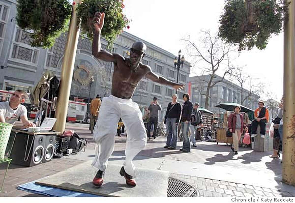 JACKSON01_108_RAD.jpg SHOWN: Edward Jackson is the tap dancer most often seen tap dancing at the cable car turnaround at Powell and Market Sts. in San Francisco. He will be moving to Australia soon, then Europe, where he's been told that street artists make better livings than here. The man squatting on the far LEFT is Pavel Levchenko Edward's sound technician. These pictures were made on Sunday, Feb. 4, 2007, in San Francisco, CA. (Katy Raddatz/SF Chronicle) **Pavel Levchenko Mandatory credit for the photographer and the San Francisco Chronicle. ; mags out.