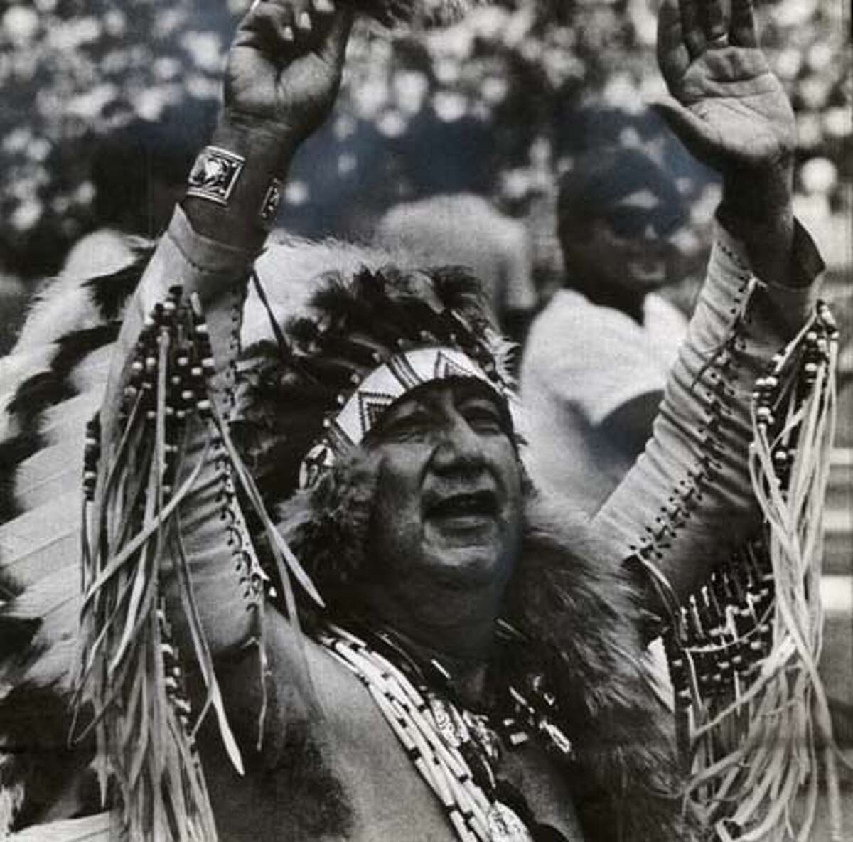 Timm Johnson, aka Chief Lightfoot cheers at a Stanford-UCLA football game Oct 6, 1979. The indian mascot had been discountinued by Stanford in 1972. This was a rare return performance by Johnson.