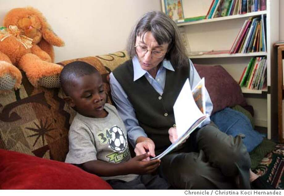CHRISTINA KOCI HERNANDEZ/CHRONICLE  Jefferson Award Winner Linda Lazzareschi, with client, Amir Randall, 3 1/2, she reads to him, Linda started the Women's Daytime Drop-in Center in Berkeley to provide services and a daytime place to go for homeless women and their children.  We need photos of Linda in action at the center (with clients and/or staff)  The Jefferson Awards profiles is a weekly series honoring community public service running every Saturday for the next year in the Opinion pages. It is a joint project between KPIX/CBS5 and KCBS radio and part of a national award project Photo: CHRISTINA KOCI HERNANDEZ