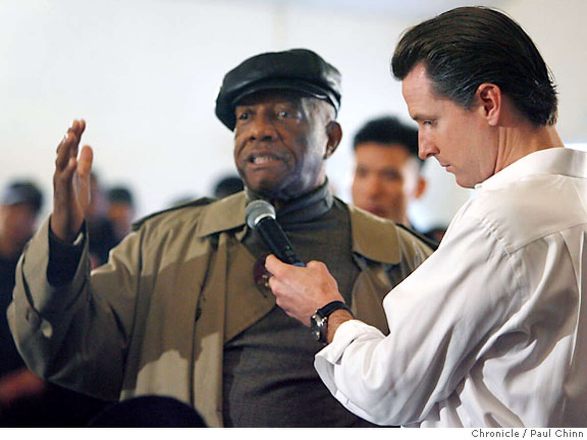Mayor Gavin Newsom held the microphone for Charlie Walker who wanted to discuss traffic concerns along the Third Street light rail corridor during a town hall meeting for the Bayview neighborhood at the Whitney Young Community Center in San Francisco, Calif. on Saturday, February 10, 2007. PAUL CHINN/The Chronicle **Charlie Walker