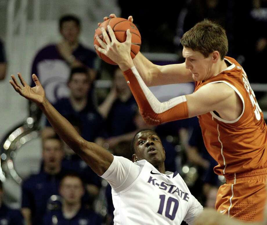 Texas forward/center Clint Chapman (53) beats Kansas State forward Victor Ojeleye (10) to a rebound during the first half of an NCAA college basketball game on Wednesday, Jan. 18, 2012, in Manhattan, Kan. (AP Photo/Charlie Riedel) Photo: Charlie Riedel / AP