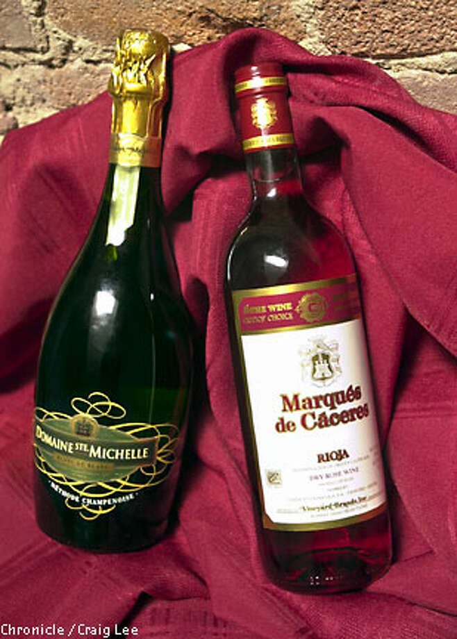 Domaine Ste. Michelle Blanc de Blanc sparkling wine from Washington state ($10) is crisp and effervescent, and the 2001 Marques de Caceres Rioja Rosado ($8) has excellent balance. Chronicle photo by Craig Lee