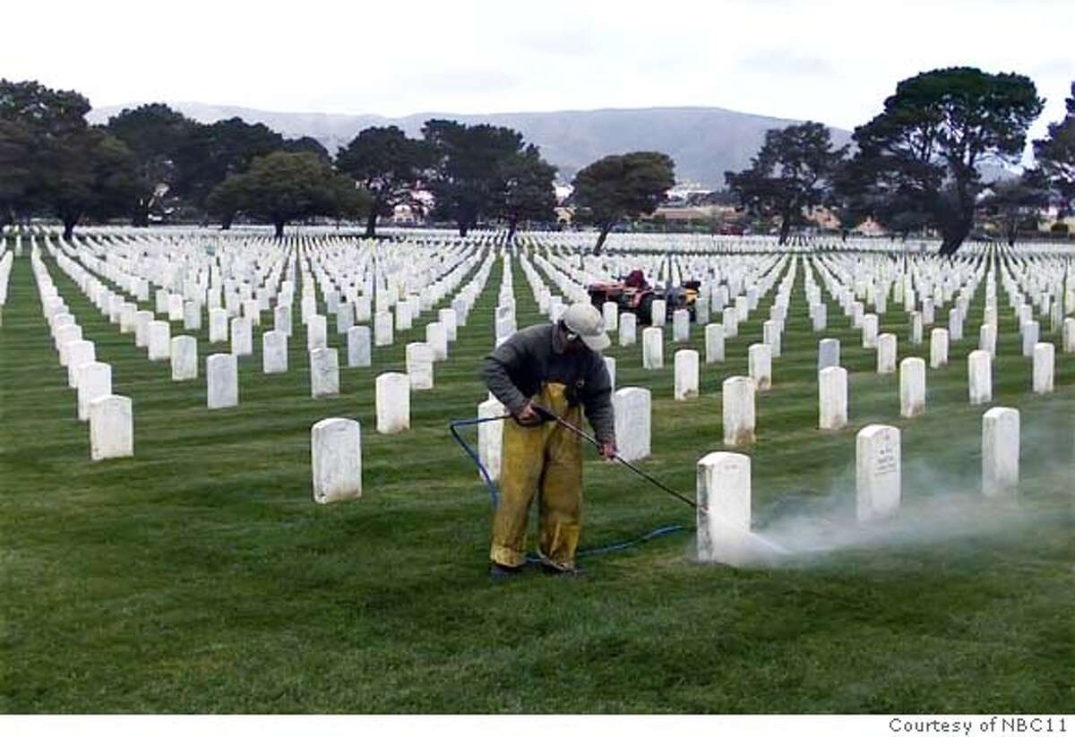 """Photo from the caretaker of the veterans cemetery in Colma. This photo shows a caretaker powerwashing the sidewalk at the cemetary to keep it """"pristine."""""""