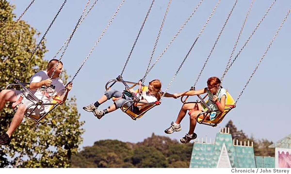 Story about then Sonoma County Fair in Santa Rosa. Kids having fun on the YoYo ride. John Storey Santa Rosa Event on 7/28/05 -