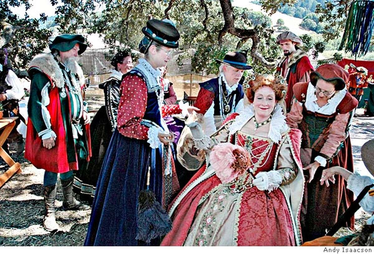 Deborah Doyle plays Queen Elizabeth (lady seated, right) surrounded by her courtiers. Deborah Doyle is a fund raiser for the San Francisco Public Library in her real life, and says that sometimes her husband addresses her as
