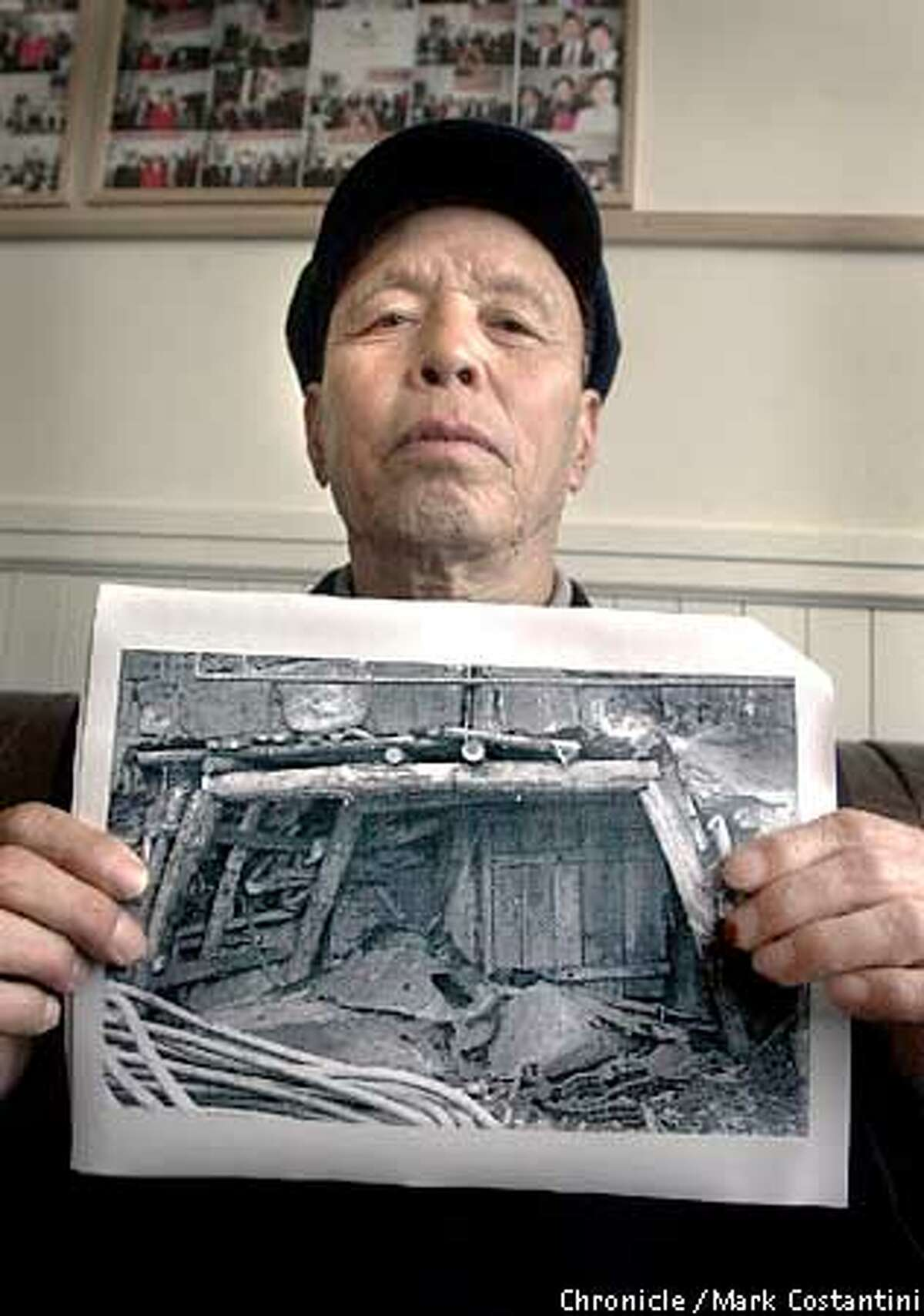 Yun De Li, a Chinese citizen, holds a picture of a cole mine in Japan he was forced to work in during World War II. Press conference with people who accuse Japanese firms Mitsubishi and Mitsui of using Chinese citizens and American WWII POW's as slave labor during that war. 5/2/03 in San Francisco. MARK COSTANTINI / The Chronicle