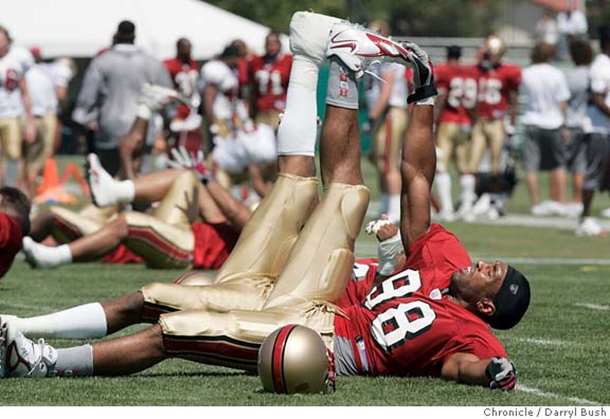 49ers_204_db.jpg San Francisco 49ers Julian Peterson (98) stretches on opening day of training camp at 49ers headquarters. Event on 7/30/05 in Santa Clara. Darryl Bush / The Chronicle MANDATORY CREDIT FOR PHOTOG AND SF CHRONICLE/ -MAGS OUT