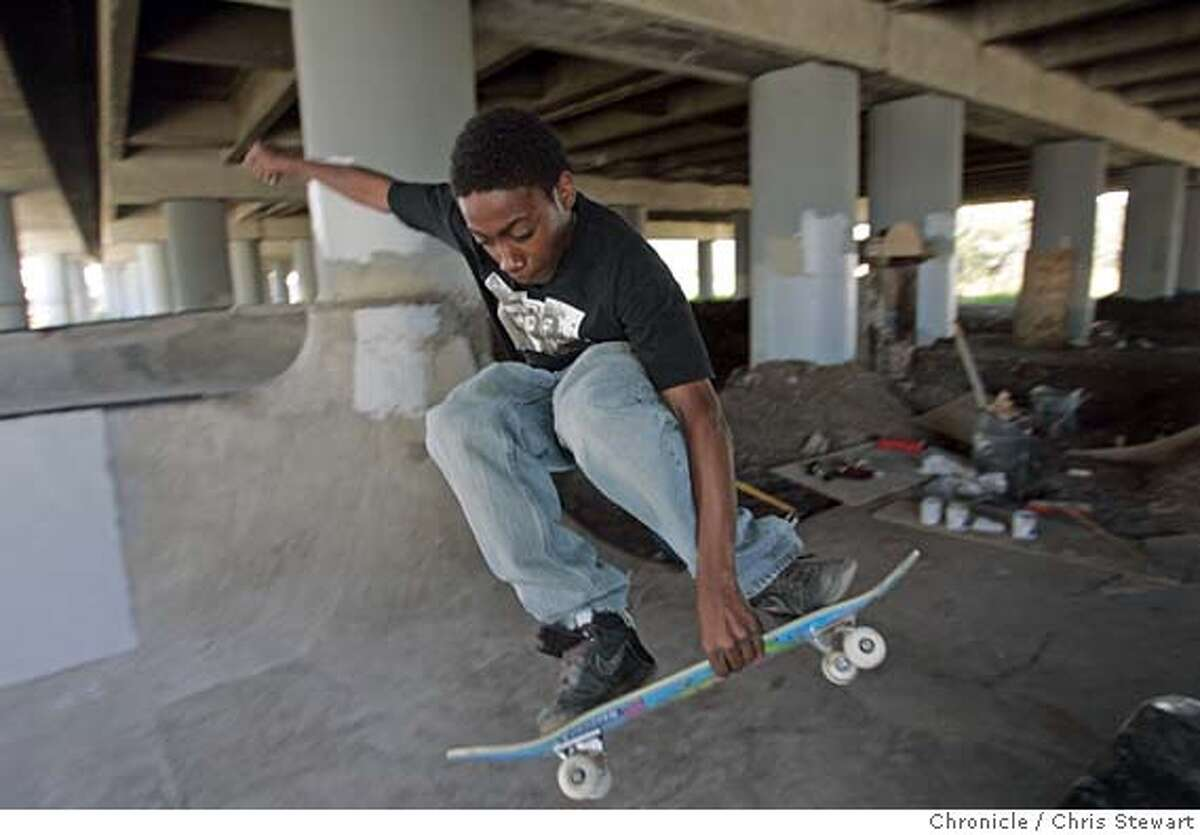 skatepark030316.jpg Event on 8/2/05 in Oakland. D'ontae Smith, 15, of Oakland gets air in a skate park that a group of skateboarders have for over a year been building in an undeveloped stretch of land beneath an elevated section of Interstate 580 in West Oakland. Using their own money and labor the group has moved tons of earth and brick to create the park. But Caltrans posted fliers at the site saying they were going to demolish the skate park Wednesday, August 3, 2005. The land had been used by drug dealers, drug users and homeless people, and nearby businesses applauded the new park. Chris Stewart / The Chronicle MANDATORY CREDIT FOR PHOTOG AND SF CHRONICLE/ -MAGS OUT