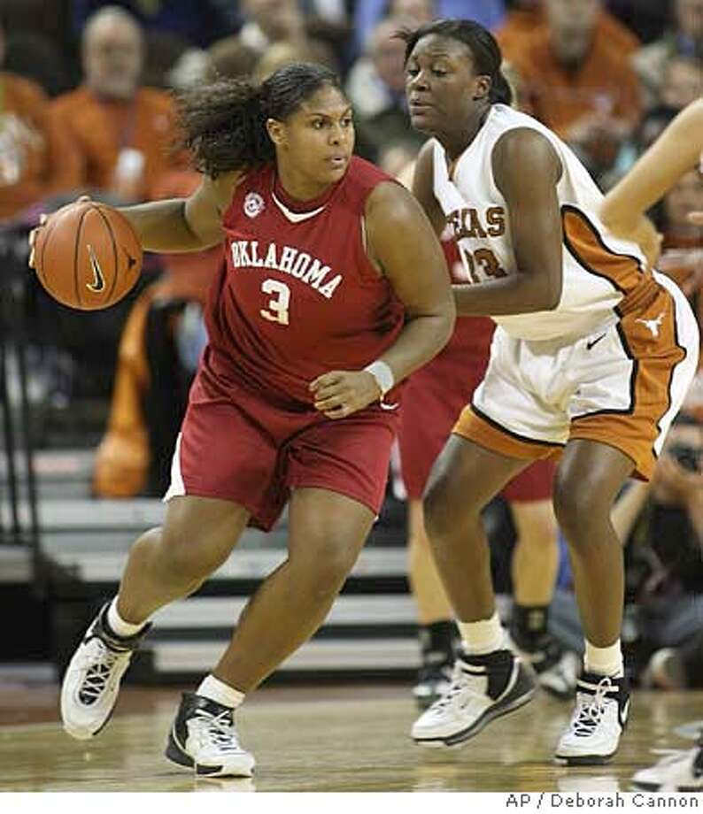 Oklahoma's Courtney Paris (3) moves around Texas' Tiffany Jackson during the first half of their basketball game in Austin, Texas on Wednesday, Jan. 31, 2007. Texas beat Oklahoma 67-62. Paris scored 25 points, Jackson scored 22. (AP Photo/Deborah Cannon) Photo: Deborah Cannon