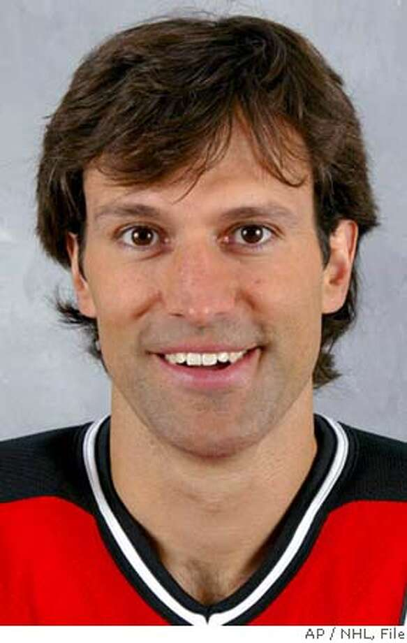 ** FILE ** This 2003 handout from the NHL shows Scott Niedermayer. Scott Niedermayer has left the New Jersey Devils to play with his brother on the Anaheim Mighty Ducks. Niedermayer, the NHL's top defenseman in the 2003-04 season, agreed to a four-year, $27 million deal Thursday Aug. 4, 2005 that will take him across the country and make him a teammate of his brother Rob. (AP Photo/ho, NHL) 2003 HANDOUT PHOTOS. MAGS OUT.