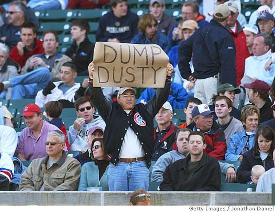 "CHICAGO - OCTOBER 3: A disgruntled fan of the Chicago Cubs holds a sign saying ""Dump Dusty,"" referring to Cubs manager Dusty Baker, during a game against the Atlanta Braves on October 3, 2004 at Wrigley Field in Chicago, Illinois. The Cubs defeated the Braves 10-8. (Photo by Jonathan Daniel/Getty Images) Ran on: 10-10-2004  Manager Dusty Baker took the heat for the Cubs' stretch-run collapse from broadcasters, fans and media alike. Ran on: 10-10-2004  Manager Dusty Baker took the heat for the Cubs' stretch-run collapse from broadcasters, fans and media alike. Photo: Jonathan Daniel"