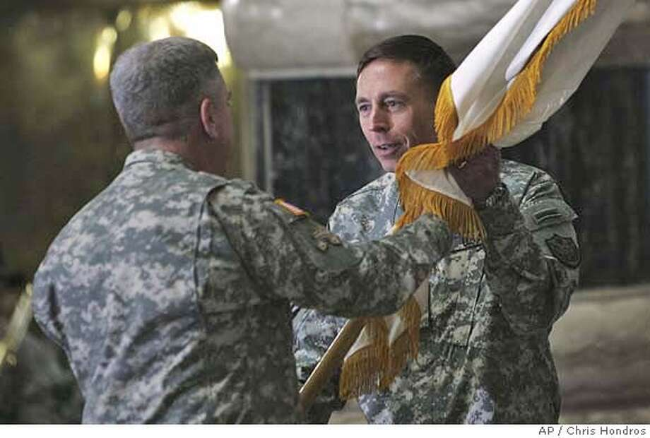 Gen. David Petraeus, right, takes the flag from Gen. John Abizaid, the outgoing Central Command chief, to become U.S. commander in Iraq Saturday, Feb. 10, 2007, in Baghdad, Iraq. Petraeus took command from Gen. George Casey, who will become the next U.S. Army chief of staff. (AP Photo/Chris Hondros, Pool) Photo: CHRIS HONDROS