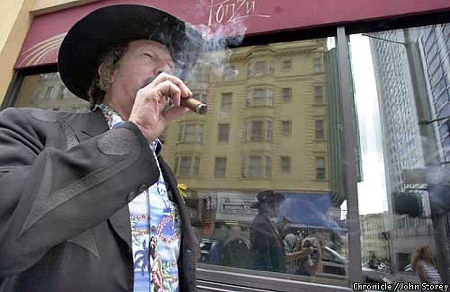 KINKY-C-11APR03-DD-JRS-Author Kinky Friedman on the streets of San Francisco with his cigar. Chronicle photo by John Storey. Photo: John Storey