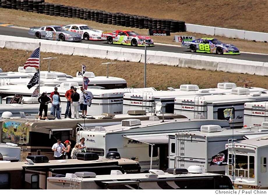 nascarhome_023_pc.jpg  NASCAR fans watch a preliminary race from the roof of a motor home parked near the Save Mart 350 course. Kevin Hamlin, crew chief for NASCAR driver Jeff Burton, and his wife Patti host a barbecue for friends and the Cingular racing team at their motor home parked at Infineon Raceway on 6/25/05 in Sonoma, Calif. The motor home is the Hamlin's home-away-from-home during the racing season.  PAUL CHINN/The Chronicle MANDATORY CREDIT FOR PHOTOG AND S.F. CHRONICLE/ - MAGS OUT Photo: PAUL CHINN
