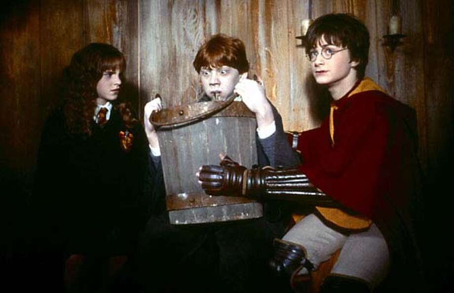 "Emma Watson as Hermione, Rupert Grint as Ron and Daniel Radcliffe as Harry, in ""Harry Potter and the Chamber of Secrets."""