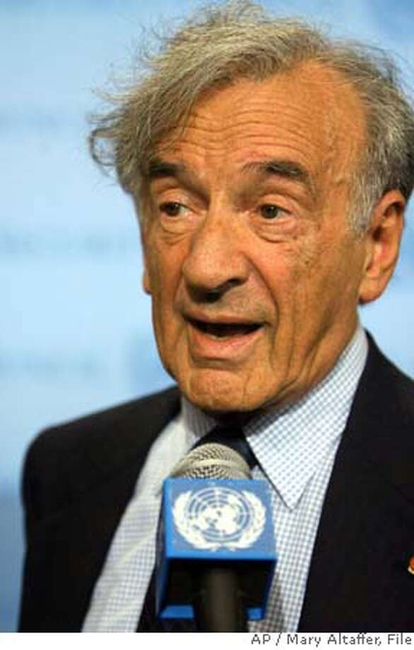 ** FILE ** Shown in this file photo is Nobel Peace Prize winner Elie Wiesel speaking to members of the media after addressing members of the Security Council on the crisis in Darfur, Thursday, Sept. 14, 2006, at United Nations headquarters. Nobel Peace laureate and Holocaust scholar Eli Wiesel was dragged from an elevator and roughly accosted, possibly by a Holocaust denier, during a peace conference at a San Francisco hotel earlier this month, police said Friday, Feb. 9, 2007.(AP Photo/Mary Altaffer) Photo: MARY ALTAFFER