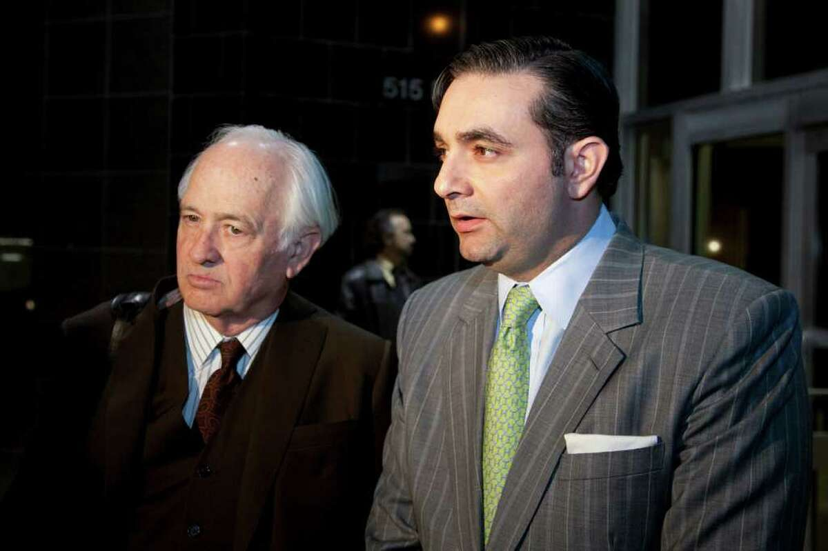 R. Allen Stanford's public defenders, Robert Scardino, left, and Ali Fazel, speak to the media after a hearing earlier this month in downtown Houston.