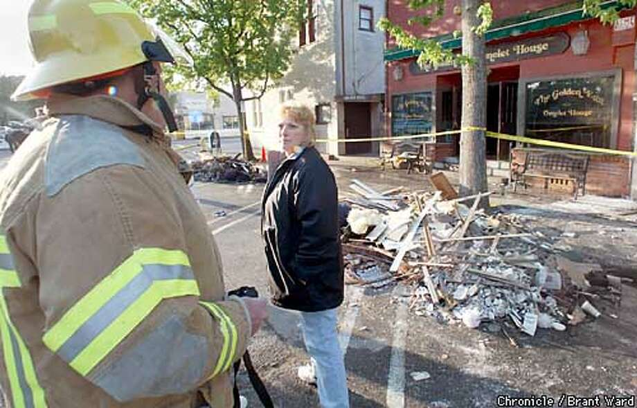 Susan Purdy, the owner of the popular Golden Egg Omelet House in downtown Novato, looks back at a Novato fireman after seeing her burned out business. The restaurant and three other stores were burned out early Monday morning...much of the furniture of one hair salon was stacked outside on Grant Avenue. BRANT WARD / The Chronicle Photo: BRANT WARD