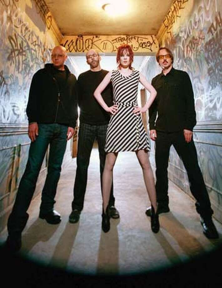 popquiz10_garbage.JPG GARBAGE are left to right: Steve Marker, Duke Erikson, Shirley Manson and Butch Vig. HANDOUT/ HANDOUT Ran on: 04-10-2005  The members of Garbage: Steve Marker (left), Duke Erikson, Shirley Manson and Butch Vig. Photo: HANDOUT