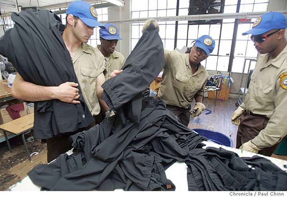 garments04_085_pc.jpg  A crew from the California Conservation Corps took inventory of garments seized by the State Labor Commissioner's office after investigators shut down the Sunrise K garment factory for various labor violations on 8/3/05 in San Francisco, Calif.  PAUL CHINN/The Chronicle MANDATORY CREDIT FOR PHOTOG AND S.F. CHRONICLE/ - MAGS OUT Photo: PAUL CHINN