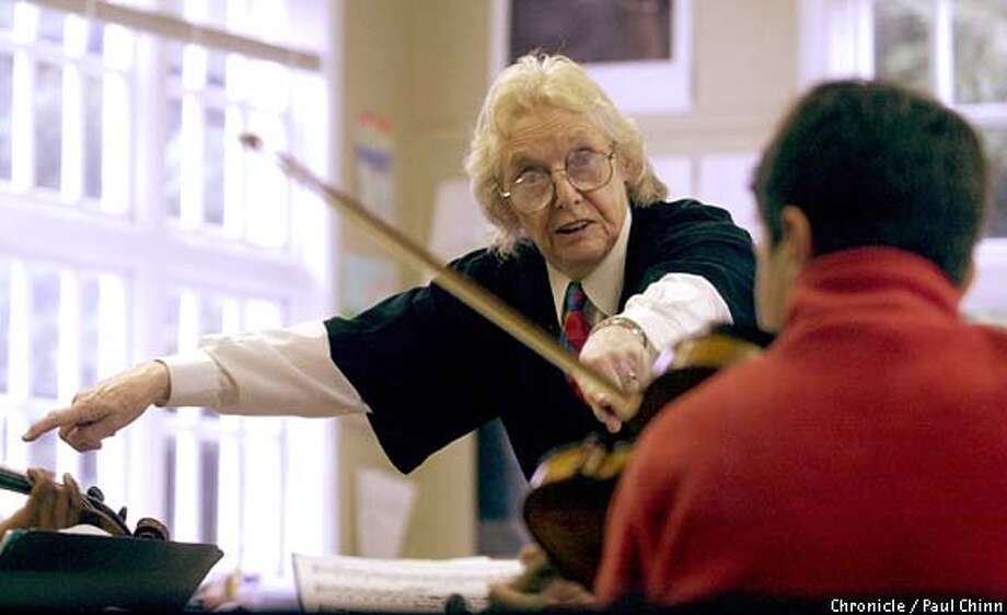 School founder and director Anne Crowden worked with Sasha Rosenthal during a rehearsal. The Crowden School combines music instruction with a regular school curriculum for 79 students between 4th and 8th grades.  PAUL CHINN/SF CHRONICLE Photo: PAUL CHINN