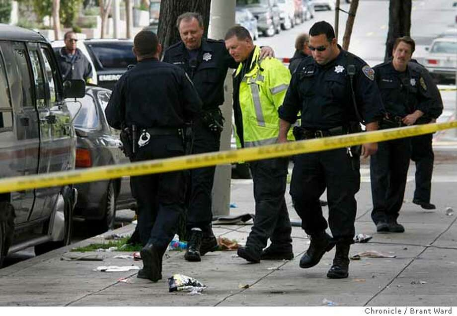 San Francisco police officers gathered and looked over the south side of Eddy Street after the shooting.  A shooting in the 1200 block of Eddy Street in San Francisco's Western Addition Sunday morning.  {Brant Ward/San Francisco Chronicle}2/11/07 Photo: Brant Ward