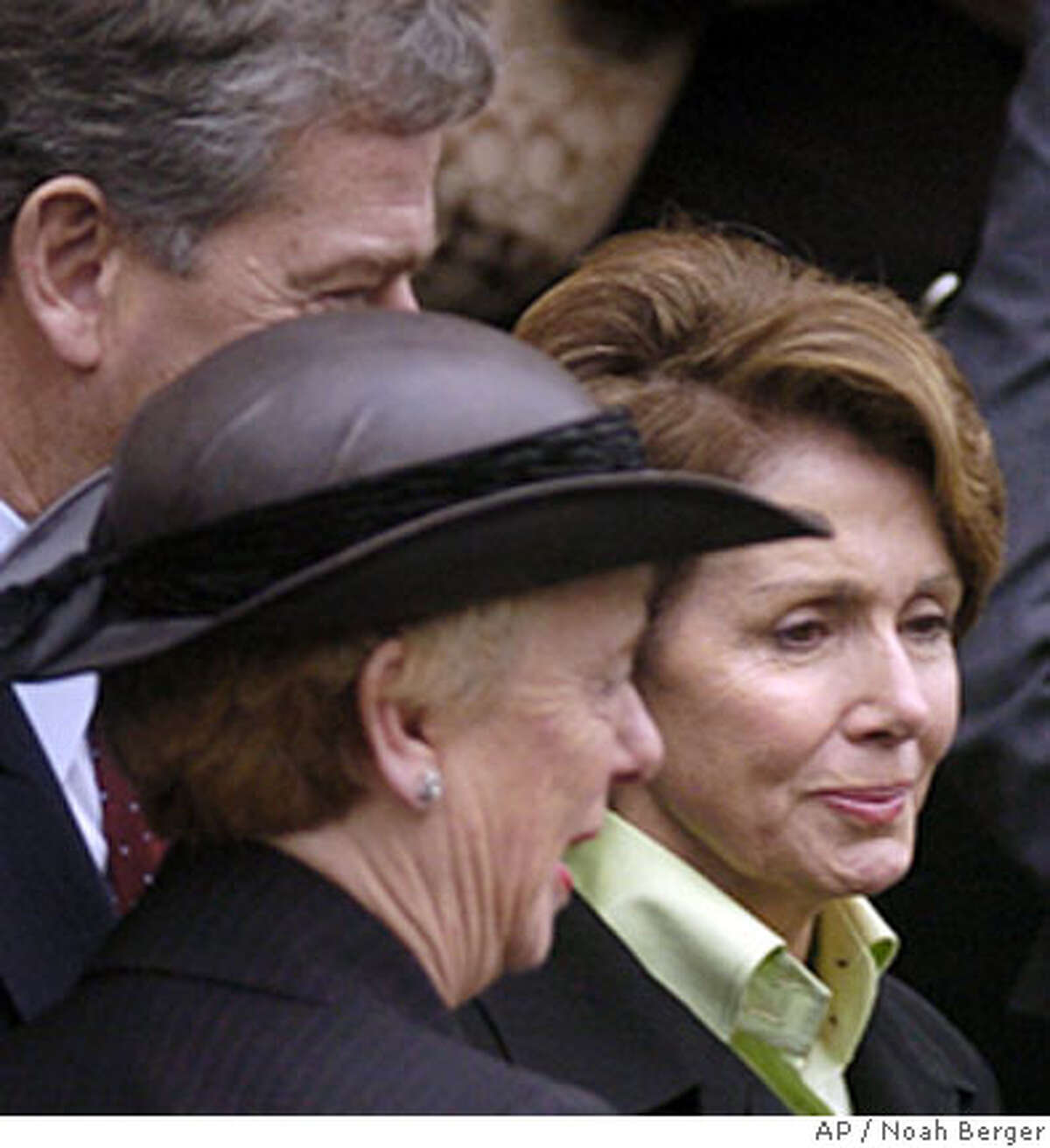 House Speaker Nancy Pelosi, right, leaves the funeral of Leo McCarthy, former speaker of the California Assembly and three term lieutenant governor, with his widow, Jackie McCarthy, on Friday, Feb. 9, 2007, in San Francisco. (AP Photo/Noah Berger)