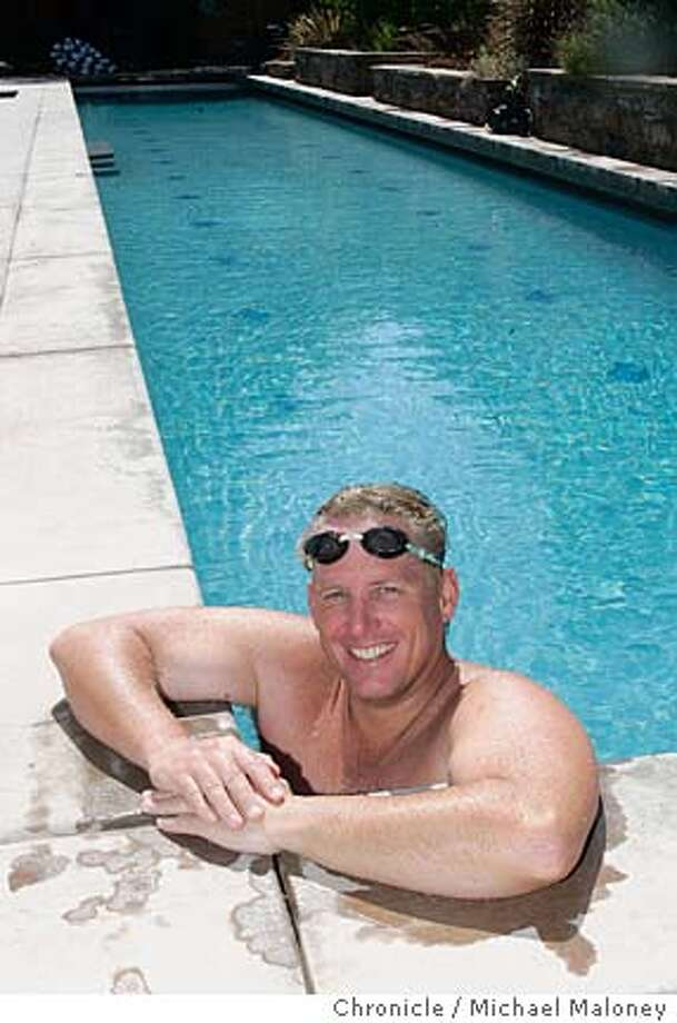 "NEVIUS05_123_MJM.jpg  Ken Harmon, from Danville, is going to attempt to swim the length of Lake Tahoe, over 20 miles, without a wet suit to try to raise $100,000 for the Danville Aquatic Center. The swim isn't until Aug. 22, but he is doing two ""warmup swims'' of Donner Lake on the sixth and seventh. He trains at home where he has an Olympic-sized lap pool.  Photo by Michael Maloney / San Francisco Chronicle MANDATORY CREDIT FOR PHOTOG AND SF CHRONICLE/ -MAGS OUT Photo: Michael Maloney"