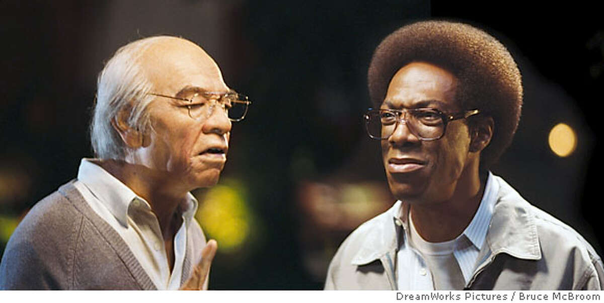N-C1113-08A_C1112-12 Mr. Wong (EDDIE MURPHY, left), who found Norbit (EDDIE MURPHY, right) on his doorstep as a baby, gives the young man some fatherly advice in �Norbit.� DreamWorks Pictures Presents �Norbit,� a John Davis production of a Brian Robbins film, starring Eddie Murphy, Thandie Newton, Eddie Griffin, Terry Crews, Clifton Powell, Katt Williams, Lester �Rasta� Speight, and Cuba Gooding, Jr. Photo credit: Bruce McBroom