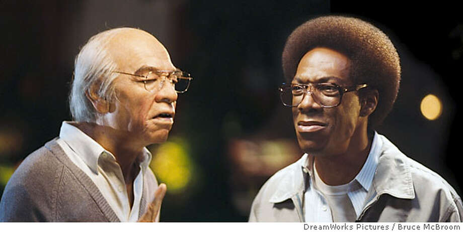 N-C1113-08A_C1112-12 Mr. Wong (EDDIE MURPHY, left), who found Norbit (EDDIE MURPHY, right) on his doorstep as a baby, gives the young man some fatherly advice in �Norbit.� DreamWorks Pictures Presents �Norbit,� a John Davis production of a Brian Robbins film, starring Eddie Murphy, Thandie Newton, Eddie Griffin, Terry Crews, Clifton Powell, Katt Williams, Lester �Rasta� Speight, and Cuba Gooding, Jr. Photo credit: Bruce McBroom Photo: Bruce McBroom