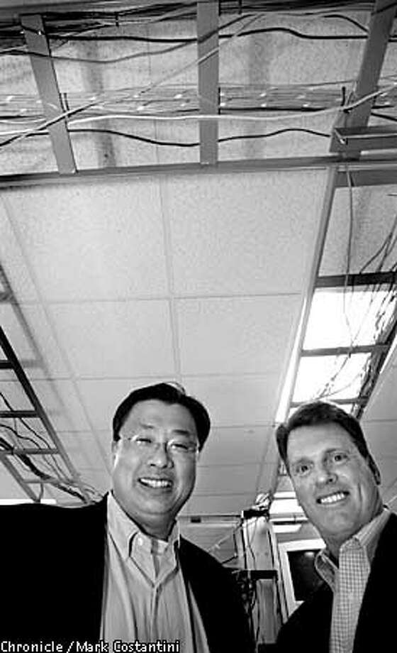 Hong Lu(CEO) and Mike Sophie(CFO) of UTStarcom. They make equipment for for big phone and internet companies. -- for Top 200. 4/28/03 in Alameda. MARK COSTANTINI / The Chronicle Photo: MARK COSTANTINI