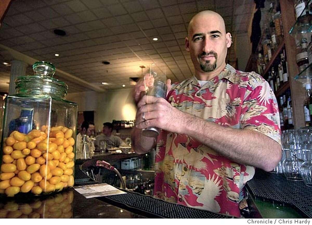 Enrico's bar manager David Nepove making the Kumquat Caipiroshka