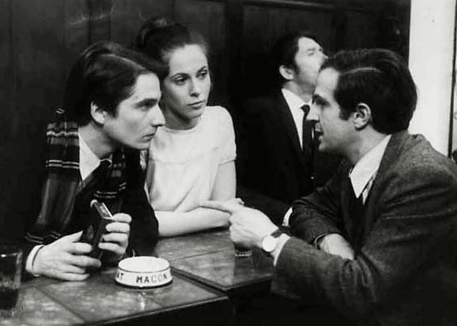 "Francois Truffaut (right) discusses a scene in ""Stolen Kisses"" with stars Jean-Pierre Leaud (left) and Claude Jade"