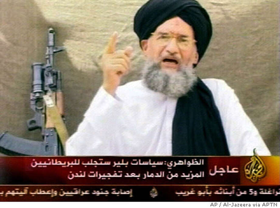** EDS NOTE: THE ASSOCIATED PRESS HAS NO WAY OF INDEPENDENTLY VERIFYING THE CONTENT, LOCATION OR DATE OF THIS VIDEO ** This image made from an undated video broadcast Thursday, Aug. 4, 2005 on pan-Arab satellite channel Al-Jazeera, shows al-Qaida's Ayman al-Zawahri speaking Kalashnikov rifle propped up behind him at an undisclosed location. In the video, al-Zawahri threatened more destruction in London, saying British Prime Minister Tony Blair would be to blame. (AP Photo /Al-Jazeera via APTN) Photo: AL-JAZEERA