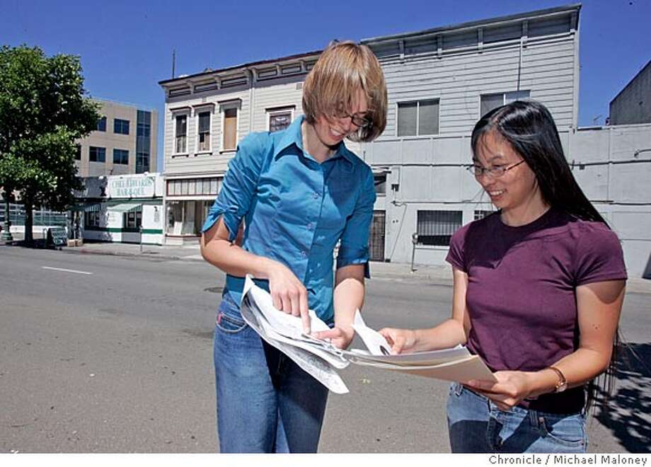 """Archaeologist Anna Naruta (left) and UC Berkeley anthropology student Kelley Fong stand on the site of one of the old chinatowns on San Pablo near 20th Street in Oakland. Behind them are two buildings built in the late 1800's, which displaced some of the original San Pablo Avenue Chinatown residents. Naruta is hoping the city of Oakland will preserve them as part of the chinatown history.  Historians have uncovered the underground remnants of a """"Chinatown"""" that once thrived at 20th St. and San Pablo Ave. in Oakland. This Chinatown was one of several that existed in Oakland from the mid-1800s till the early-1900s. Eventually, development led to the abandonment of all the Chinatowns but one -- the existing neighborhood centered at 7th and Webster streets. Photo by Michael Maloney / San Francisco Chronicle Photo: Michael Maloney"""