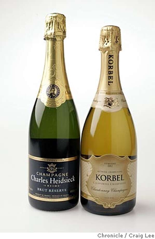 "Photo of Charles Heidsieck Champagne from France (left) and Korbel Champagne from California (right). Winemakers from Champagne, Portugal, Washington, Oregon and California meeting to draft a declaration of joint principals on the need to protect wine origins. Vintners are concerned about mislabeling of wines such as brands that don't use Napa Valley grapes use ""Napa,"" as part of their name brand.  Event on 7/27/05 in San Francisco. Craig Lee / The Chronicle Photo: Craig Lee"