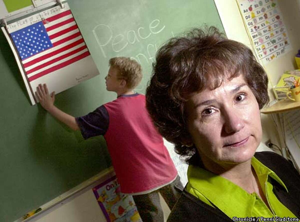 Susan Petersen, principle at Silverwood Elementary School in Concord. 5th grade student in background is Johnny Endriss. SAN FRANCISCO CHRONICLE PHOTO BY PENNI GLADSTONE