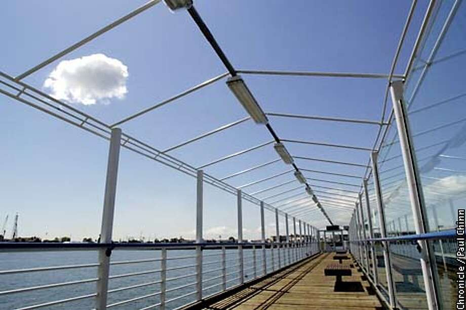 The canvas canopy covering the Oakland ferry boat's pier at the end of Clay St. has been missing for several weeks exposing the waiting passengers to the bright sun.  PAUL CHINN/SF CHRONICLE Photo: PAUL CHINN
