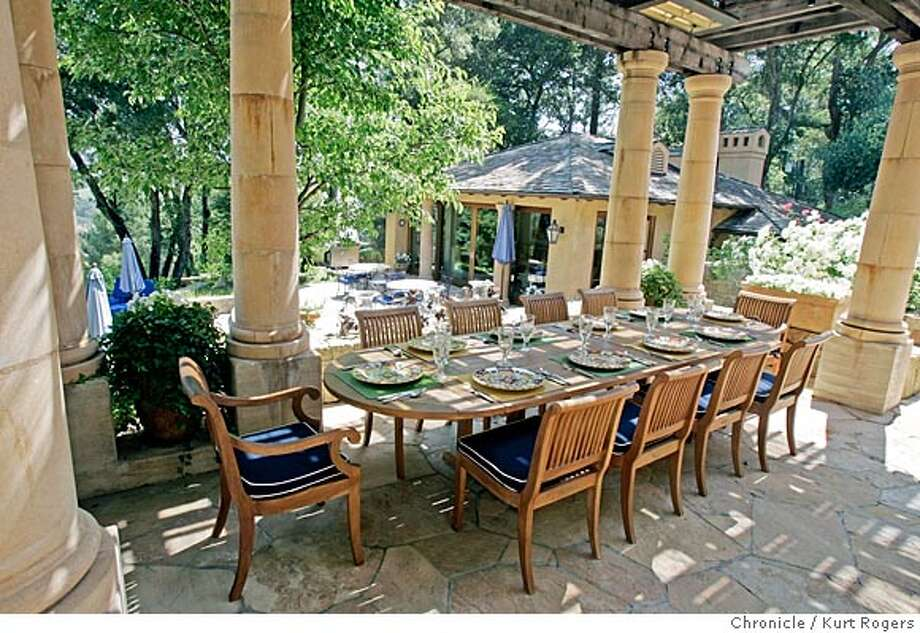 D.R. Stephens estate in the Napa Valley. An outdoor dining room can be a deck with a cover over it that's open-air, but they are generally fully furnished with proper dining table, etc. 7/5/05 in Napa,CA.  KURT ROGERS/THE CHRONICLE Photo: KURT ROGERS