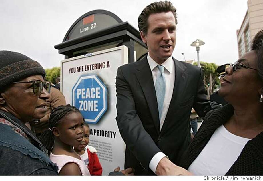 """PEACE03_077_kk.JPG  Mayor Newsom works the crowd after the poster (background) was unveiled. No ID's on this crowd shot  Mayor Gavin Newsom helps unveil a bus poster proclaiming a """"Peace Zone"""" at the corner of Fillmore and Golden Gate (cq-- the assignment said corner of Turk and Fillmorem but it was Golden Gate). Organizers Sharen (cq) Hewitt and Mattie Scott address the crowd before the ceremony.  San Francisco Chronicle Photo by Kim Komenich Photo: Kim Komenich"""