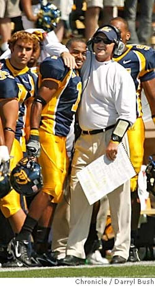 CAL_0007_db.JPG  California head coach Jeff Tedford hugs DeSean Jackson in the 2nd qtr. after a Cal TD vs. Arizona State at Memorial Stadium in Berkeley, CA on Saturday, September 23, 2006. 9/23/06  Darryl Bush / The Chronicle ** roster (cq)  Ran on: 10-26-2006  Cal coach Jeff Tedford has corralled such players as DeSean Jackson (No. 1) to Berkeley, leading to the Bears' resurgence.  Ran on: 10-26-2006 Ran on: 10-26-2006  Cal coach Jeff Tedford has corralled such players as DeSean Jackson (No. 1) to Berkeley, leading to the Bears' resurgence. MANDATORY CREDIT FOR PHOTOG AND SF CHRONICLE/ -MAGS OUT Photo: Darryl Bush