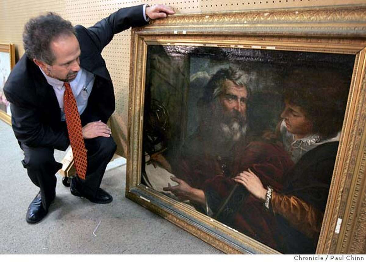 Redge Martin shows The Chronicle a painting by Italian artist Pier Francisco Mola at Clars Auction Gallery in Oakland, Calif. on Wednesday, Feb. 7, 2007. The auction house estimated its value at $3,000-$5,000 but an anonymous buyer from the East Coast purchased the painting for $620,900 during an auction this past weekend. PAUL CHINN/The Chronicle **Redge Martin