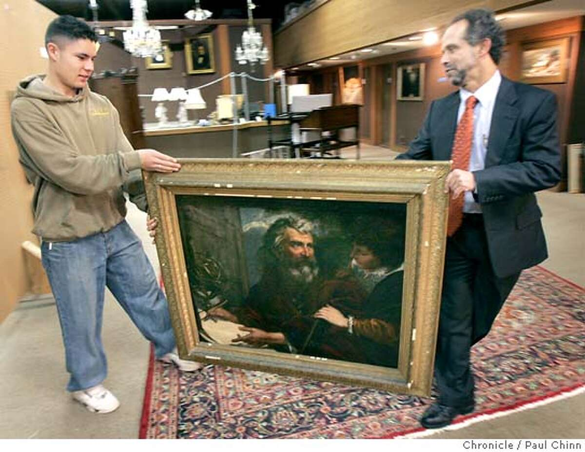 Rigoberto Partida (left) and Redge Martin shows The Chronicle a painting by Italian artist Pier Francisco Mola at Clars Auction Gallery in Oakland, Calif. on Wednesday, Feb. 7, 2007. The auction house estimated its value at $3,000-$5,000 but an anonymous buyer from the East Coast purchased the painting for $620,900 during an auction this past weekend. PAUL CHINN/The Chronicle **Rigoberto Partida, Redge Martin