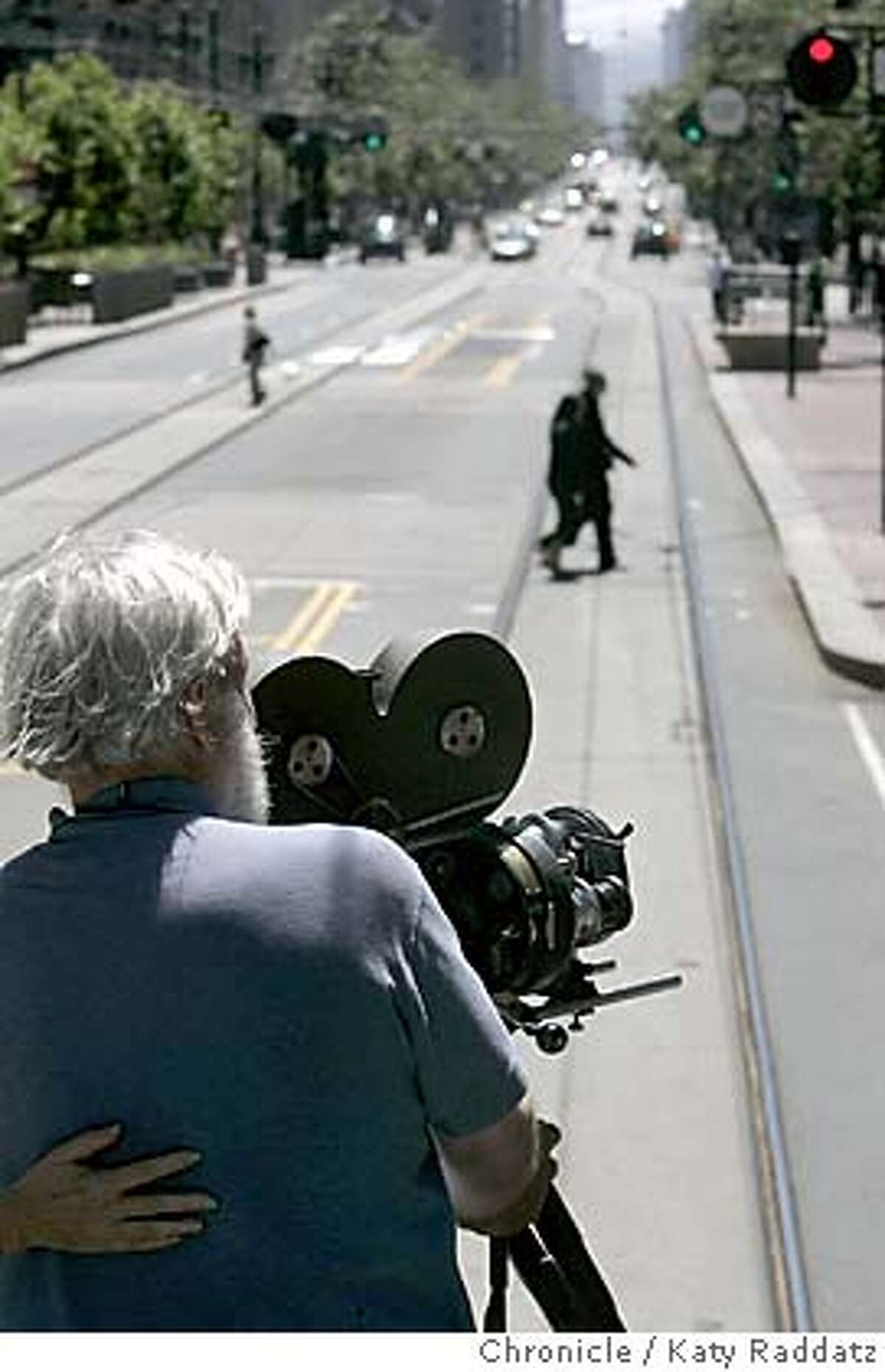MARKETFILM03233_RAD.JPG In 1905 a San Francisco filmmaker made a film by attaching a camera to a trolley car and had it move east on Market St. On July 24, 2005 the historic footage was re-created by Melinda Stone and Sprague Anderson. Their cameras were on board a 1917 work trolley run by the Muni. SHOWN: Sprague Anderson (grey hair) is the cameraman with the Bell and Howell Standard camera Dave Ford is the reporter for Datebooki. Photo taken on 7/24/05, in San Francisco, CA. By Katy Raddatz / The San Francisco Chronicle MANDATORY CREDIT FOR PHOTOG AND SF CHRONICLE/ -MAGS OUT