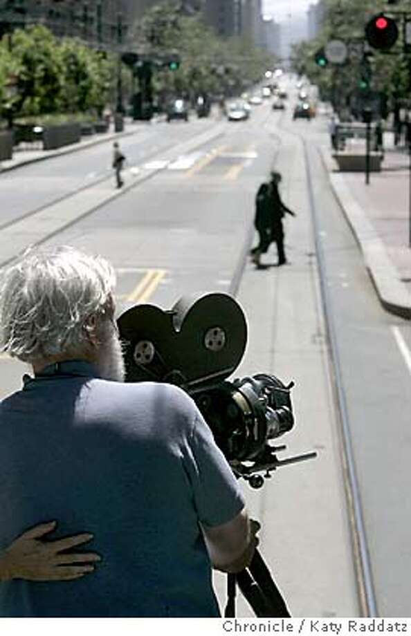 MARKETFILM03233_RAD.JPG In 1905 a San Francisco filmmaker made a film by attaching a camera to a trolley car and had it move east on Market St. On July 24, 2005 the historic footage was re-created by Melinda Stone and Sprague Anderson. Their cameras were on board a 1917 work trolley run by the Muni. SHOWN: Sprague Anderson (grey hair) is the cameraman with the Bell and Howell Standard camera Dave Ford is the reporter for Datebooki. Photo taken on 7/24/05, in San Francisco, CA.  By Katy Raddatz / The San Francisco Chronicle MANDATORY CREDIT FOR PHOTOG AND SF CHRONICLE/ -MAGS OUT Photo: Katy Raddatz