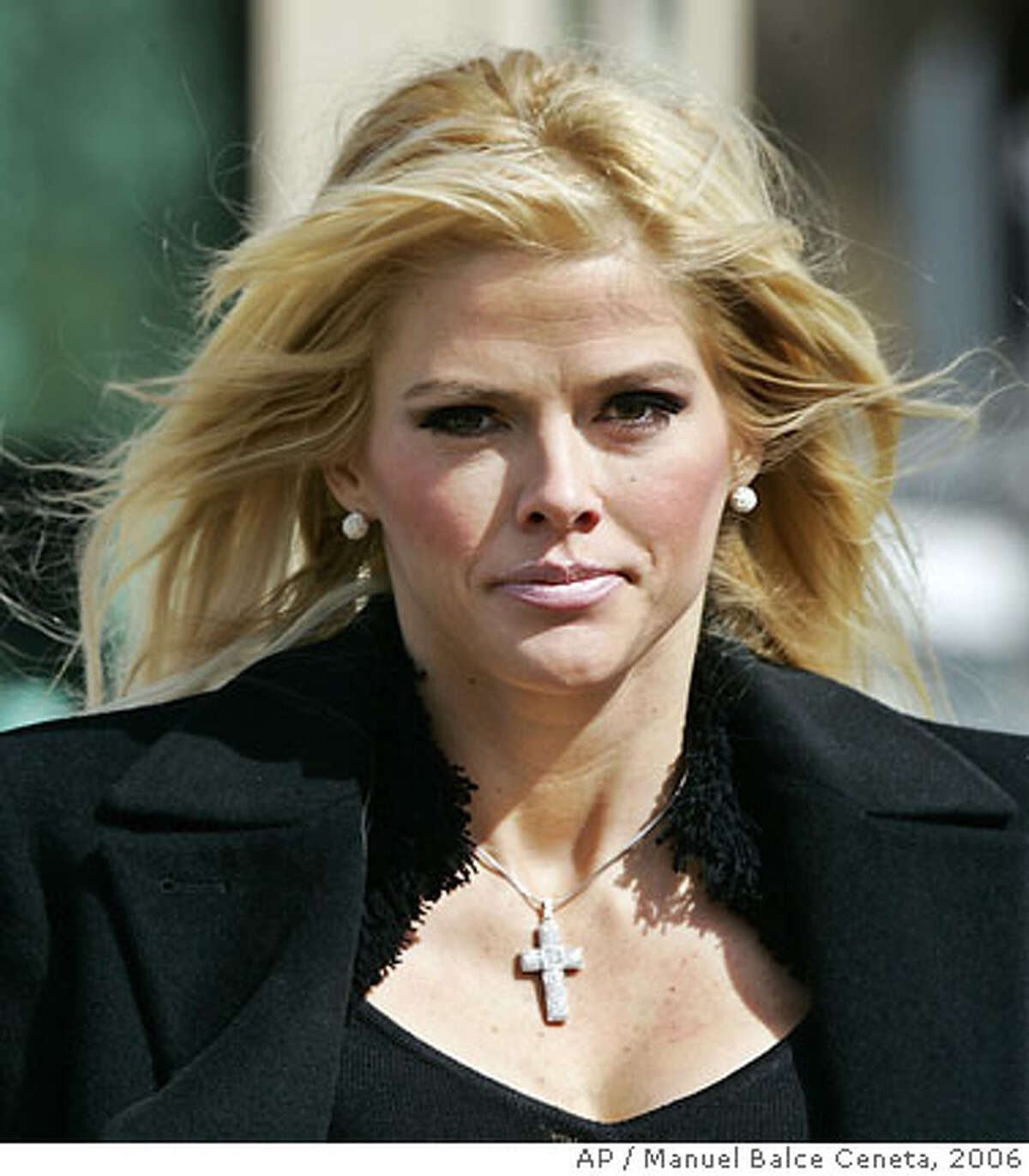 ** FILE ** Anna Nicole Smith, leaves the U.S. Supreme Court, in this Feb. 28, 2006, file photo in Washington. Smith was hospitalized in Hollywood, Fla., Thursday Feb. 8, 2007, after collapsing.. (AP Photo/Manuel Balce Ceneta)