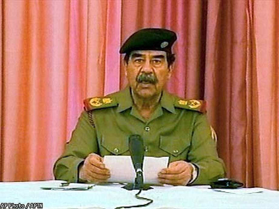 President Saddam Hussein appears in this image from video at an undisclosed location in Iraq. The Associated Press Television News obtained the video from a former employee of the Iraqi satellite television channel. The employee said the video was made on April 9, 2003 the day American troops streamed into central Baghdad and pulled down a towering Saddam statue. (AP Photo / APTN)